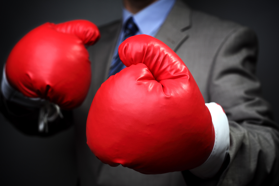 Tough competitive business concept businessman wearing boxing gl